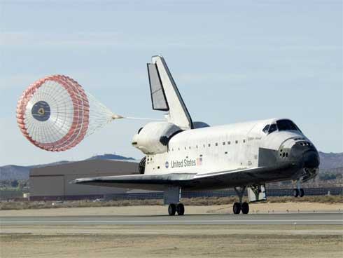 Space Shuttle Endeavour With Chute Deployed